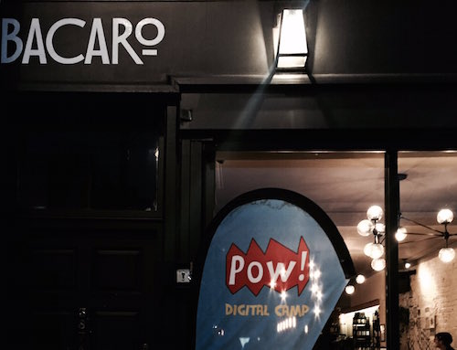Roman Road's Bacaro restaurant at night with POW Digital Camp teardrop banner outside